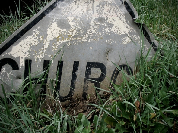 Church Sign Sunk Into Ground